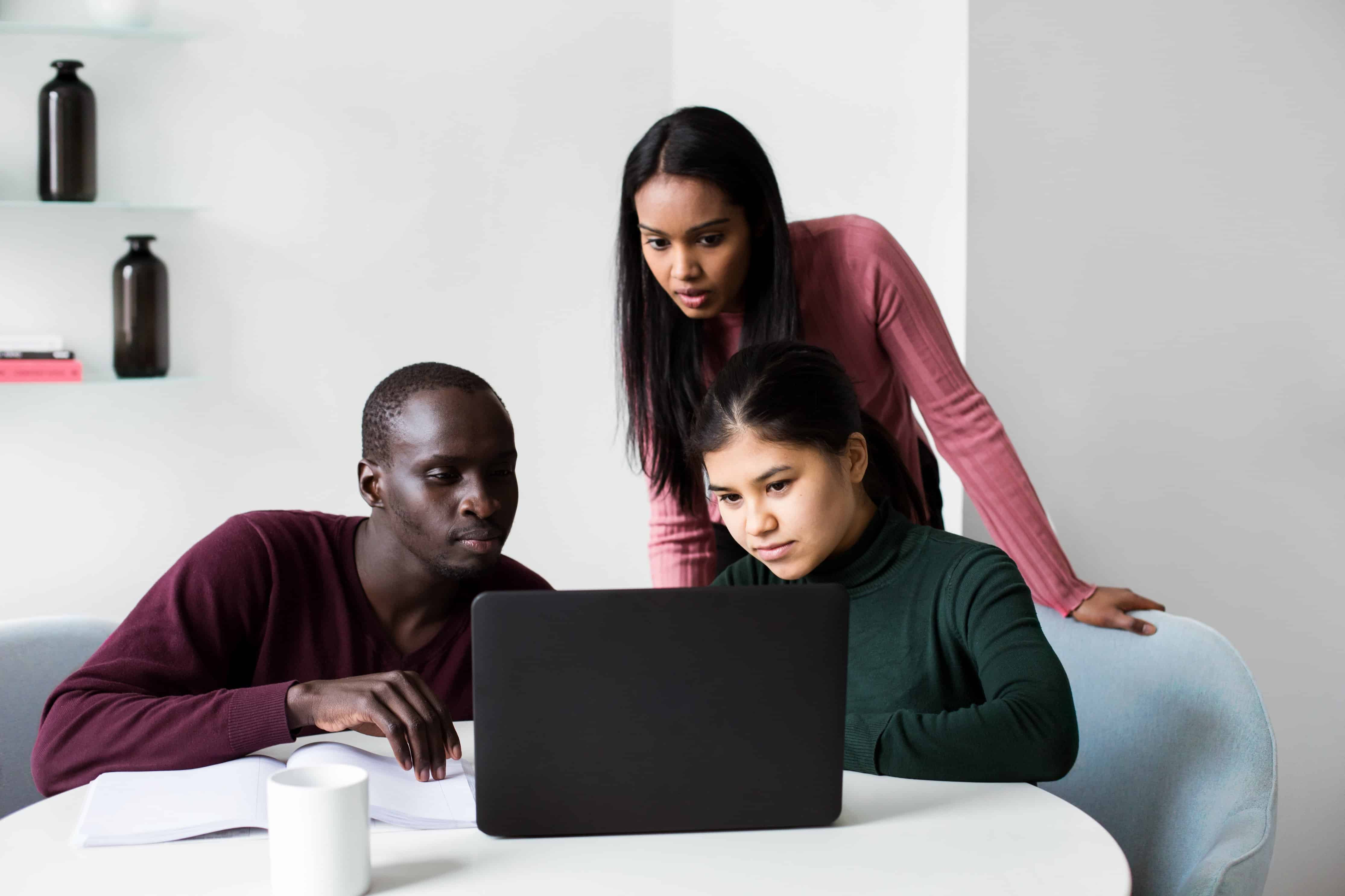 team looking at laptop